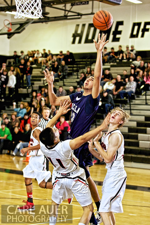 A Lincoln player is fouled as he goes to the hoop against Pomona