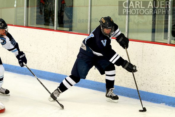 December 11th, 2012: A Valor Christian hockey player tries to control the puck in the game against the Ralston Valley Mustangs at the APEX Ice Arena on Tuesday night