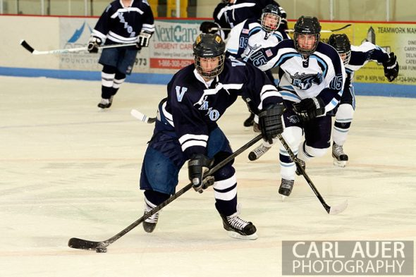 December 11th, 2012: A Valor Christian hockey player makes a break up the ice with the puck in the game against the Ralston Valley Mustangs at the APEX Ice Arena on Tuesday night