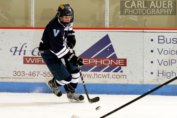 December 11th, 2012: A Valor Christian hockey player with the puck in the game against the Ralston Valley Mustangs at the APEX Ice Arena on Tuesday night