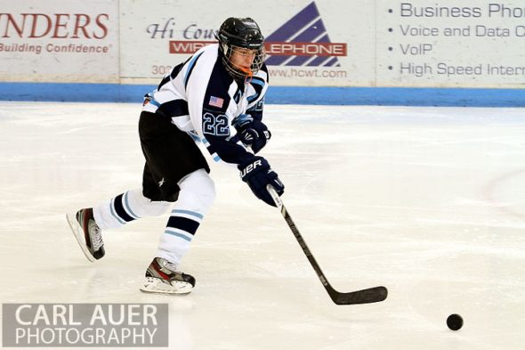 December 11th, 2012: A Ralston Valley hockey player chases the puck  down the ice in the game against the Ralston Valley Mustangs at the APEX Ice Arena on Tuesday night