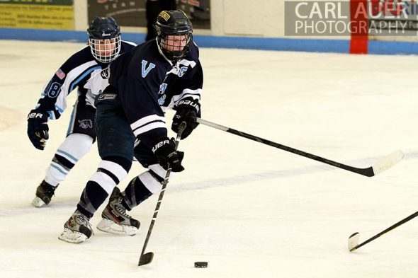 December 11th, 2012: A Valor Christian hockey player brings the puck across the blue line in the game against the Ralston Valley Mustangs at the APEX Ice Arena on Tuesday night