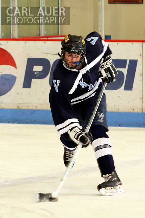December 11th, 2012: A Valor Christian hockey player slaps a shot in the game against the Ralston Valley Mustangs at the APEX Ice Arena on Tuesday night