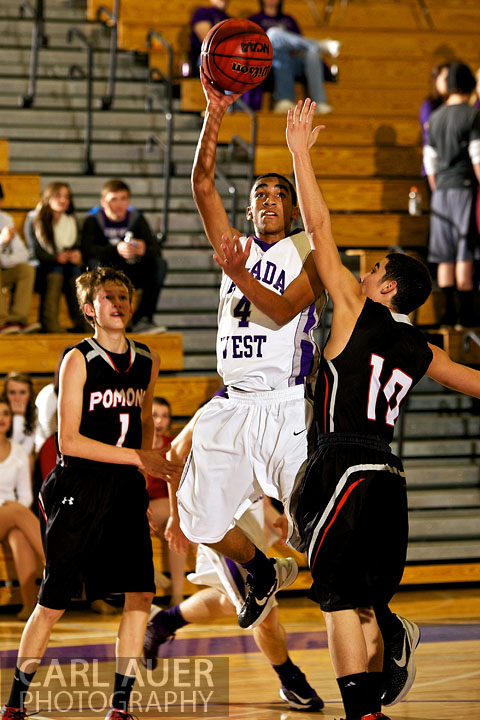 December 20, 2012: Arvada West Wildcat sophomore guard Dhillon Greene (4) splits the Pomona Panther defense as he takes a shot in the game between Pomona and Arvada West on Thursday night at Arvada West High School.