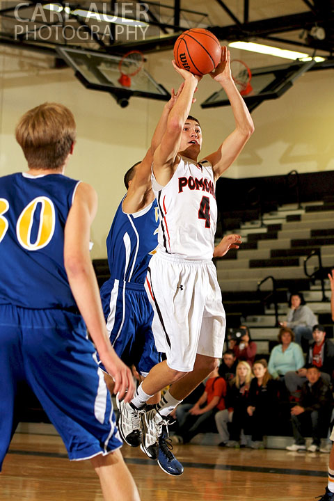 December 14, 2012: Pomona Panther senior guard Mitch Colin (4) elevates for a jump shot against the Wheat Ridge Farmers on Friday night at Pomona High School.