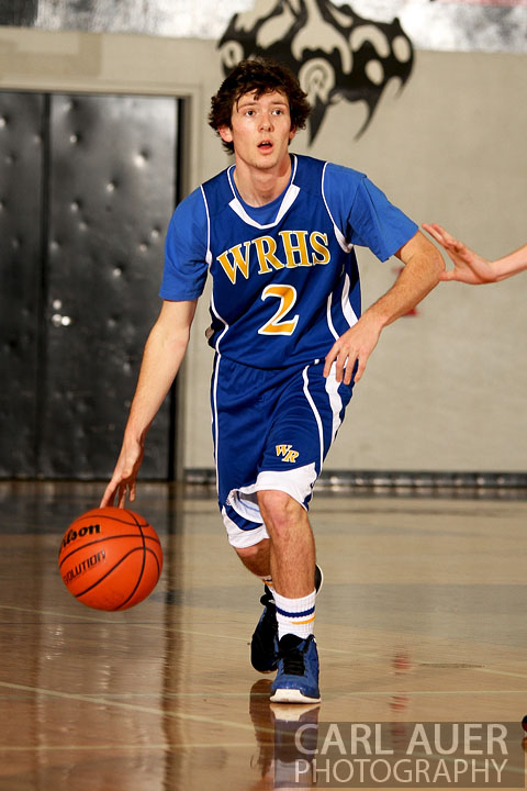 December 14, 2012: Wheat Ridge Farmer senior Noah Brookman (2) brings the ball up the court against the Pomona Panthers on Friday night at Pomona High School.