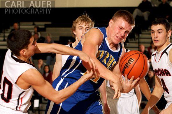 December 14, 2012: Wheat Ridge Farmer senior Tyler Kubasta (11) grabs a rebound in the game against the Pomona Panthers on Friday night at Pomona High School.