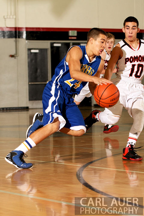 December 14, 2012: Wheat Ridge Farmer sophomore Jordan Jones (24) takes the ball to the hoop against the Pomona Panthers on Friday night at Pomona High School.