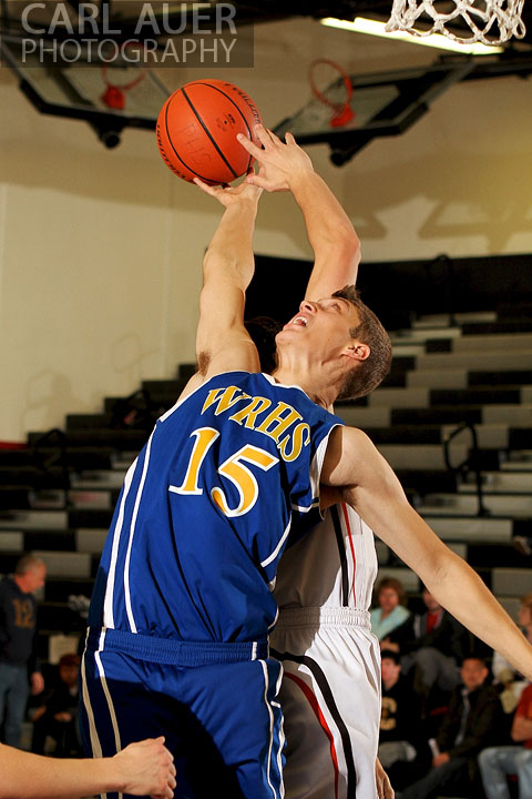 December 14, 2012: Wheat Ridge Farmer senior Stefan Pryzbylo (15) reaches back to grab a rebound against the Pomona Panthers on Friday night at Pomona High School.