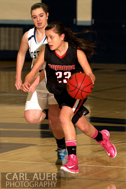 January 5th, 2013: A Pomona Panther point guard brings the ball up the court in traffic in the game against the Ralston Valley Mustangs at Ralston Valley High School.