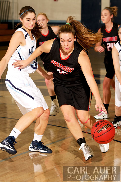 January 5th, 2013: A Pomona Panther player takes the ball past the Mustang defense in the game against the Ralston Valley Mustangs at Ralston Valley High School.