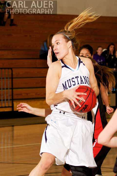 January 5th, 2013: A Ralston Valley post player spins to the hoop in the game against the Pomona Panthers at Ralston Valley High School.