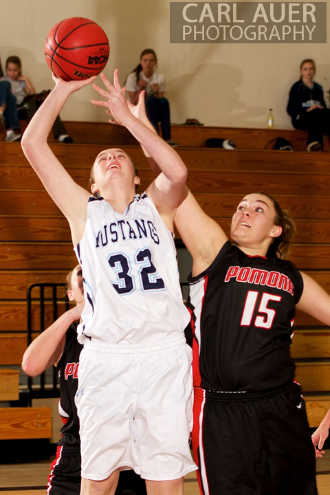 January 5th, 2013: A Pomona Panther player tries to block a shot by a Ralston Valley player in their game at Ralston Valley High School.