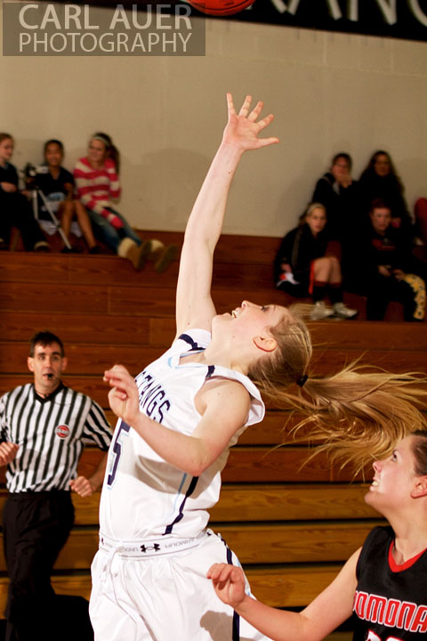 January 5th, 2013: A Ralston Valley Mustang floats a shot up in the game against the Pomona Panthers at Ralston Valley High School.
