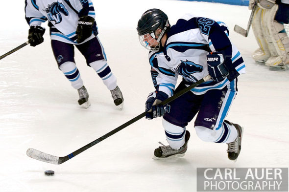 January 11th, 2013: A Ralston Valley hockey player speeds through his own zone after getting control of the puck in the game against Battle Mountain at the Apex Ice Arena on Friday night in Arvada, CO