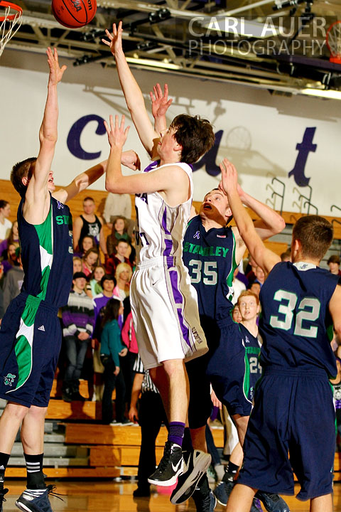 January 9th, 2013:  A Arvada West Wildcat player floats a shot over Standley Lake Gator junior Marcus Asmus in the Wildcats home game against the Standley Lake Gators on Wednesday night.