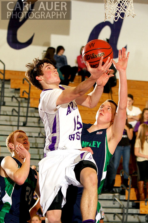 January 9th, 2013:  Arvada West Wildcat sophomore Thomas Neff (15) reverses a lay up past the Standley Lake Gators defense at Arvada West High School on Wednesday night.