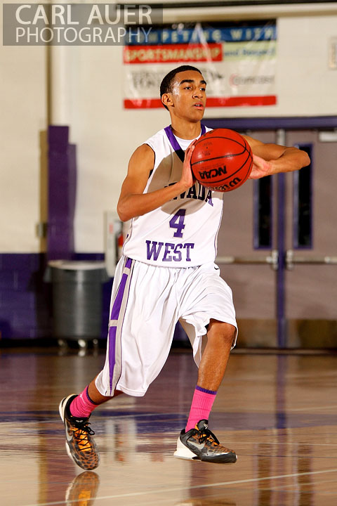 January 9th, 2013:  Arvada West Wildcat sophomore guard Dhillon Greene (4) makes a pass against the Standley Lake Gators on Wednesday night.
