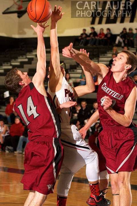 January 3rd, 2013: Chatfield Charger senior Michael Hampson (14) and teammate senior Hank Dickey (40) attempt to block a shot by a Pomona Panther's player the game against the Pomona Panthers in Arvada, CO