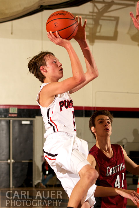 January 3rd, 2013: Pomona Panther Sophomore Javis Larson (1) floats into the lane for a shot in the Panthers game against the visiting Chatfield team from Littleton at Pomona High School in Arvada, CO