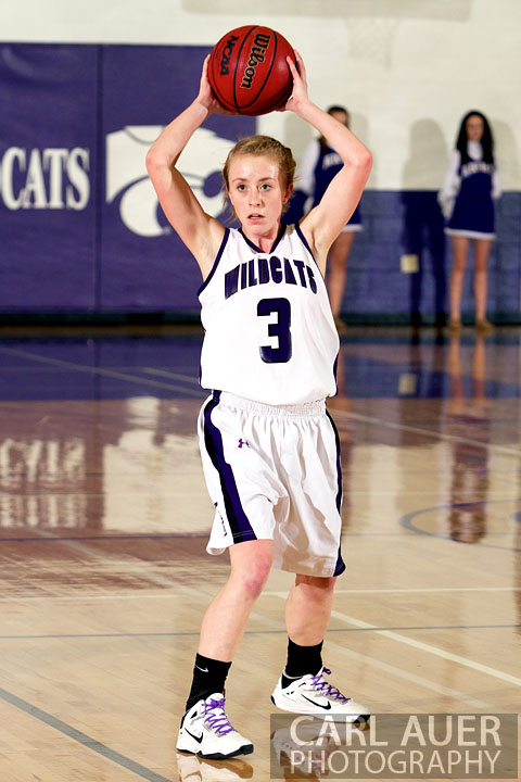 January 15th, 2013:  A Arvada West player looks to pass the ball in the game against the Columbine Rebels Tuesday night at Arvada West High School.