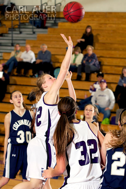 January 15th, 2013:  A Arvada West player takes a shot from the middle of the key in the game against the Columbine Rebels Tuesday night at Arvada West High School.