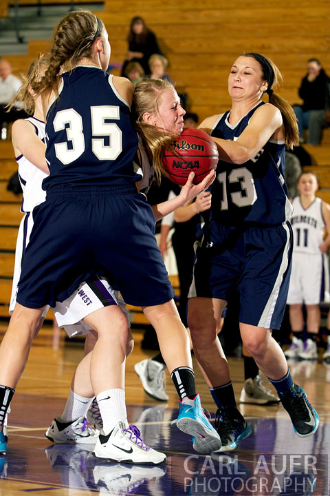 January 15th, 2013:  A Arvada West player is fouled as she fights to keep control of a rebound in the game against the Columbine Rebels Tuesday night at Arvada West High School.