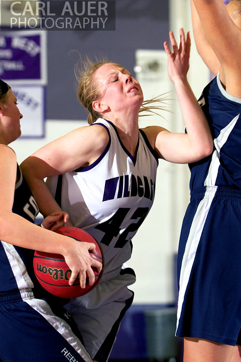 January 15th, 2013:  A Arvada West player is fouled on her way to the hoop in the game against the Columbine Rebels Tuesday night at Arvada West High School.