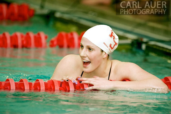 January 8th, 2013: Regis Jesuit High School swimmer and Olympic Gold medalist Missy Franklin cheers a teammate on in one of her 4 heats during the dual meet between Regis Jesuit and Highlands Ranch on Tuesday evening in Aurora, Colorado
