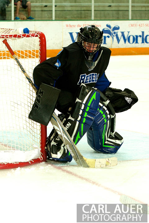 January 4th, 2013: The Columbine Rebel goalie watches the puck in the game against the Columbine Rebels at the Ice Center at the Promenade in Westminster, CO on Friday night.
