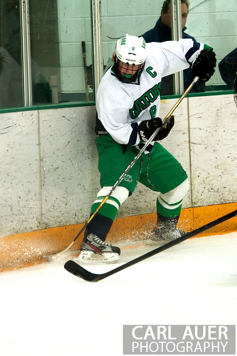 January 4th, 2013: A Standley Lake Gator takes control of the puck in the game against the Columbine Rebels at the Ice Center at the Promenade in Westminster, CO on Friday night.
