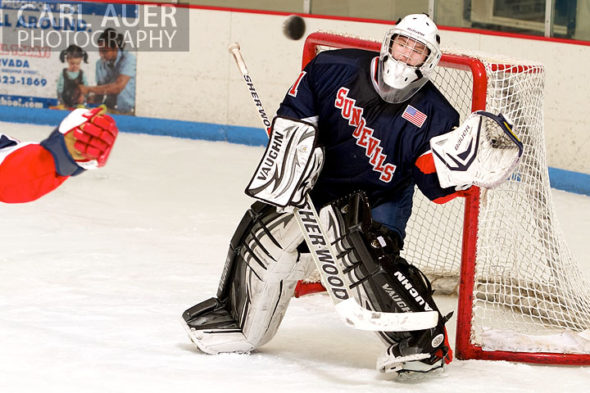 February 4th, 2013: Kent Denver Sun Devils goalie Zack Van Sky eyes the puck for a glove save as it is shot at him in the game against Ralston Valley at the Apex Ice Arena in Arvada, CO