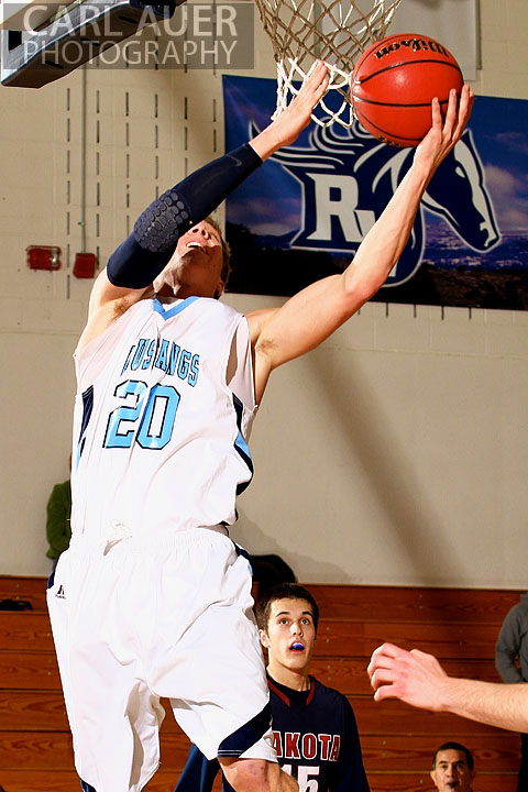 February 20th, 2013: Ralston Valley Mustang senior guard Spencer Svejcar (20) puts up a shot attempt in the game against Dakota Ridge High School at Ralston Valley High School