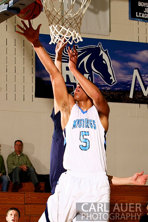 February 20th, 2013: Ralston Valley Mustang junior forward Zac Stevens (5) lays up a shot in the game against Dakota Ridge High School at Ralston Valley High School