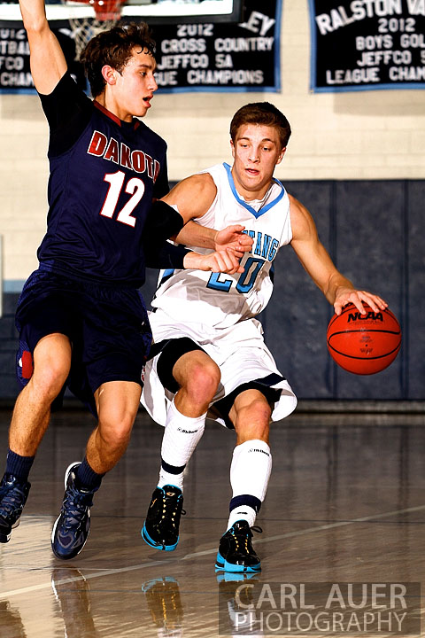 February 20th, 2013: Ralston Valley Mustang senior guard Spencer Svejcar (20) dribbles the ball up the court against the defense from Dakota Ridge Eagles junior guard Jake Flores (12) in the game between the Dakota Ridge Eagles and Ralston Valley Mustangs at Ralston Valley High School