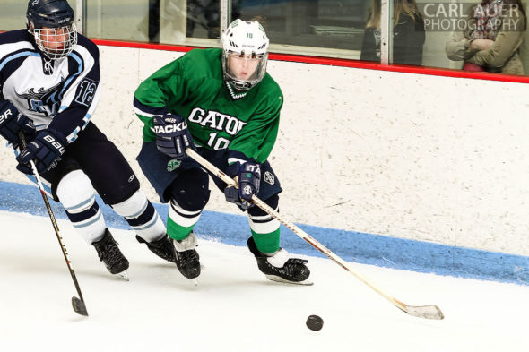 February 23, 2013: Arvada, Colorado - Standley Lake Gators forward Ryan McCarthy attempts to out skate Ralston Valley junior forward Victor Lombardi in the playoff game at the Apex Center in Arvada