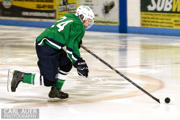 February 22, 2013: Arvada, Colorado - Standley Lake Gators forward Jeff Moffat flies down the ice with the puck in the playoff game against Valor Christian at the Apex Center in Arvada