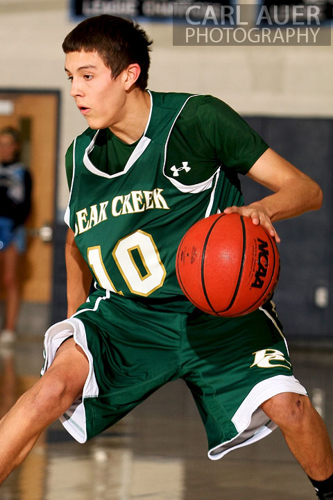 February 8th, 2013: Bear Creek Bears guard Robert Mendez dribbles the ball in the game at Ralston Valley in Arvada, Colorado