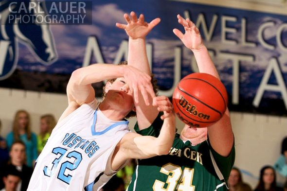 February 8th, 2013: Bear Creek Bears forward Travis Sheets (34) and Ralston Valley Mustang forward Jonathon Gillespie (32) go after the ball in their game at Ralston Valley in Arvada, Colorado