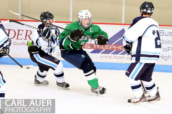 February 6th, 2013: Standley Lake Gators forward Mitch McEwan (8) attempts to split the Ralston Valley Mustang defense in their game at the Apex Ice Arena in Arvada, Colorado