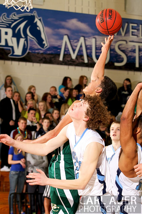 February 8th, 2013: Bear Creek Bears guard D.J. Miles (1) puts up a shot over the Ralston Valley Mustang defense in the game at Ralston Valley in Arvada, Colorado