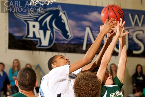 February 8th, 2013: Ralston Valley Mustang freshman forward Dallas Walton (54) tries to grab the rebound from the visiting Bear Creek Bears in their game at Ralston Valley High School in Arvada, Colorado