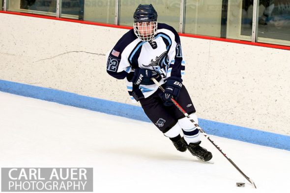 February 6th, 2013: Ralston Valley Mustang defender Victor Lombardi (12) brings the puck around the goal in the game against Standley Lake at the Apex Ice Arena in Arvada, Colorado