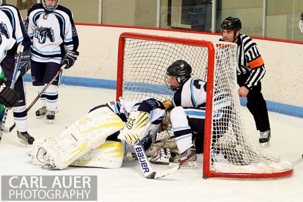 February 6th, 2013: Bodies pile into the Ralston Valley goal after Mustang goalie Zach Larocque (31) failed to stop a shot by the Standley Lake Gators in their game at the Apex Ice Arena in Arvada, Colorado