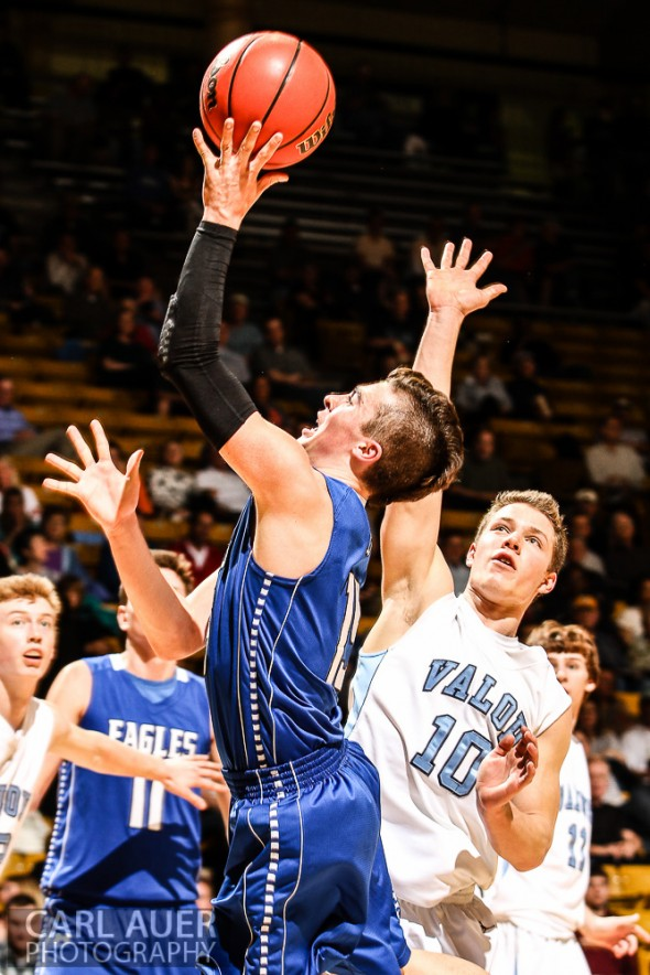 March 15th 2013:  Broomfield Eagles senior guard Parker Ericson (15) attempts a shot past Valor Christian Eagles junior Christian McCaffrey (10) in their CHSAA 4A Final Four game at the Coors Events Center in Boulder, Colorado