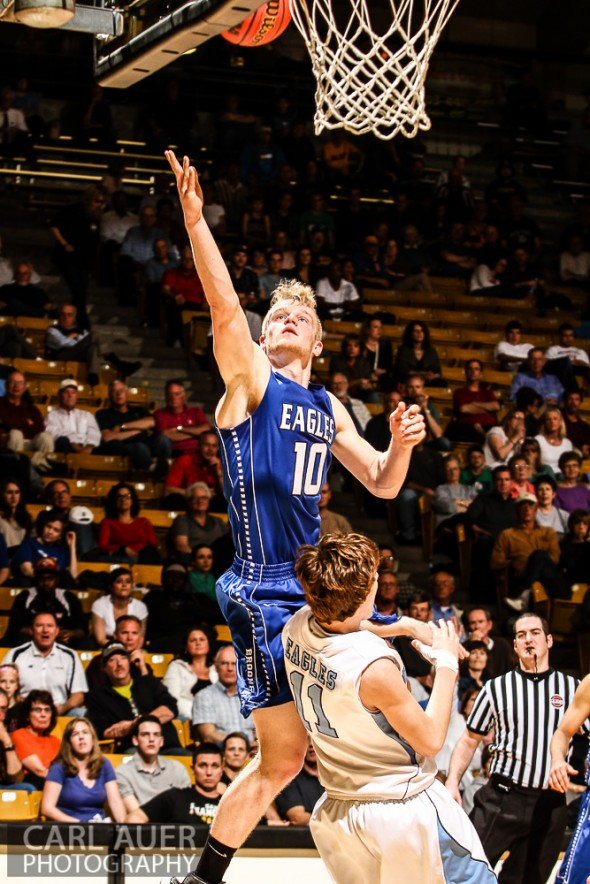 March 15th 2013:  Broomfield Eagles senior forward Dan Perse (10) attempts a lay up over Valor Christian Eagles junior Paden Mueller (11) in the first game of the CHSAA 4A Final Four game at the Coors Events Center in Boulder, Colorado