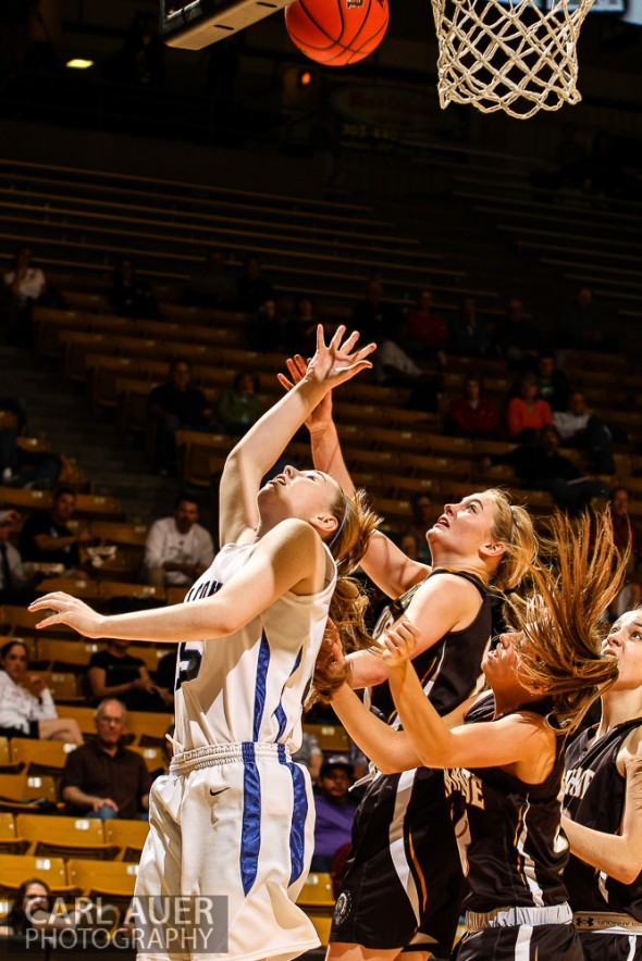 March 14th, 2013:  Highlands Ranch Falcons sophomore Logan Opheim (5) attempts a baseline lay up past the Arapahoe defense in the CHSAA 5A Girls Final Four game against the Arapahoe Warriors at the Coors Events Center in Boulder, Colorado