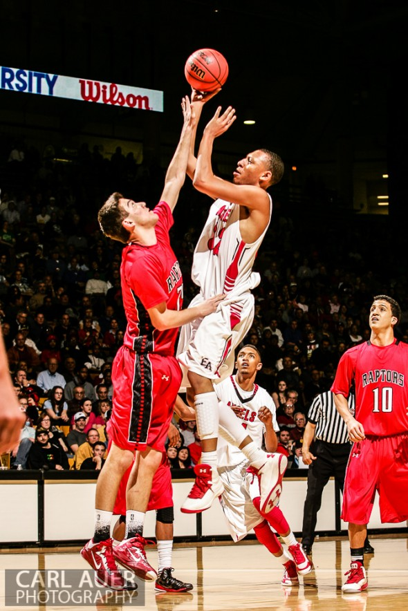 March 16th, 2013:  Denver East Angels junior forward Tyre Robinson (32) elevates for a shot over Eaglecrest Raptors sophomore forward Blend Avdili (35) in the 5A State Championship game at the Coors Events Center in Boulder, Colorado