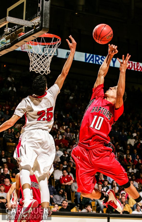 March 16th, 2013:  Denver East Angels junior guard Ronnoe Harrell (25) and Eaglecrest Raptors senior forward Sean Watkins (10) jump for a rebound in the 5A State Championship game at the Coors Events Center in Boulder, Colorado
