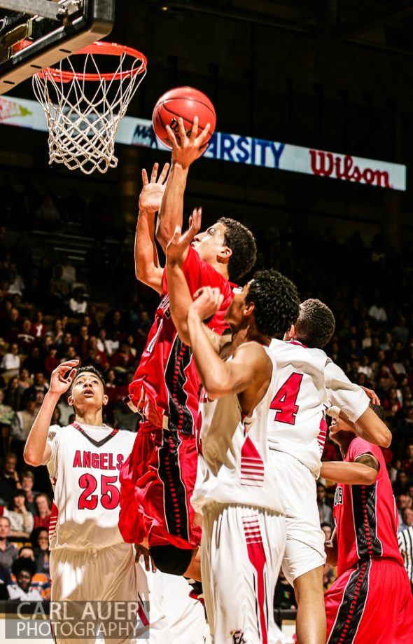 March 16th, 2013:  Eaglecrest Raptors senior forward Sean Watkins (10) elevates for a shot between the Denver East Angels defense in the 5A State Championship game at the Coors Events Center in Boulder, Colorado